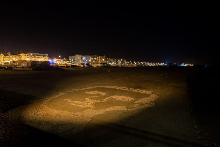 Pages-of-the-Sea-giant-sand-portrait-of-WW1-soldier-on-Weston-beach.night-image.picture-credit-Paul-Blakemore